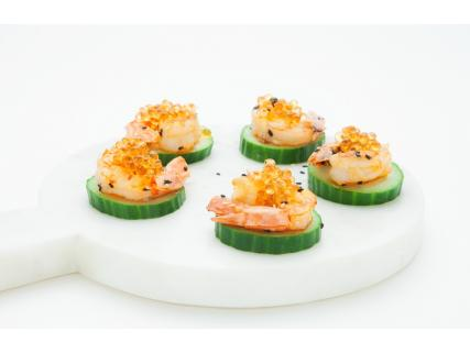 Northern Shrimp, Sesame Seeds, Lime Juice and Maple Pearls on Cucumber Slices