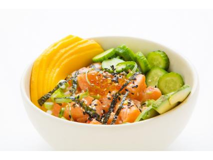 Poke bowl with salmon garnished with maple vinegar pearls